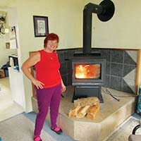 Woman standing in front of a wood stove
