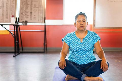 Silvia Gonzalez, organizer with Casa Latina practices mindfulness exercises.